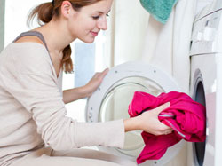 Lady Using Washing Machine